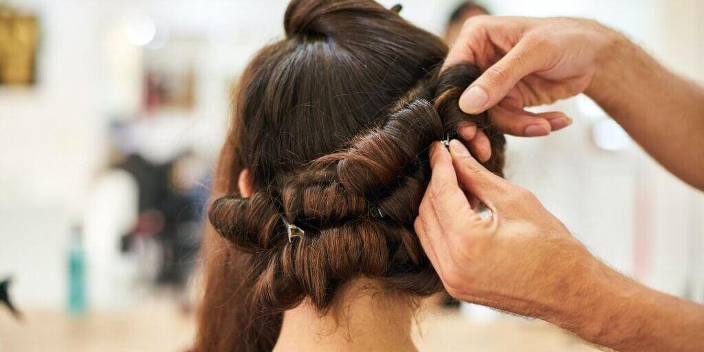 brunette hair getting pinned up in curls