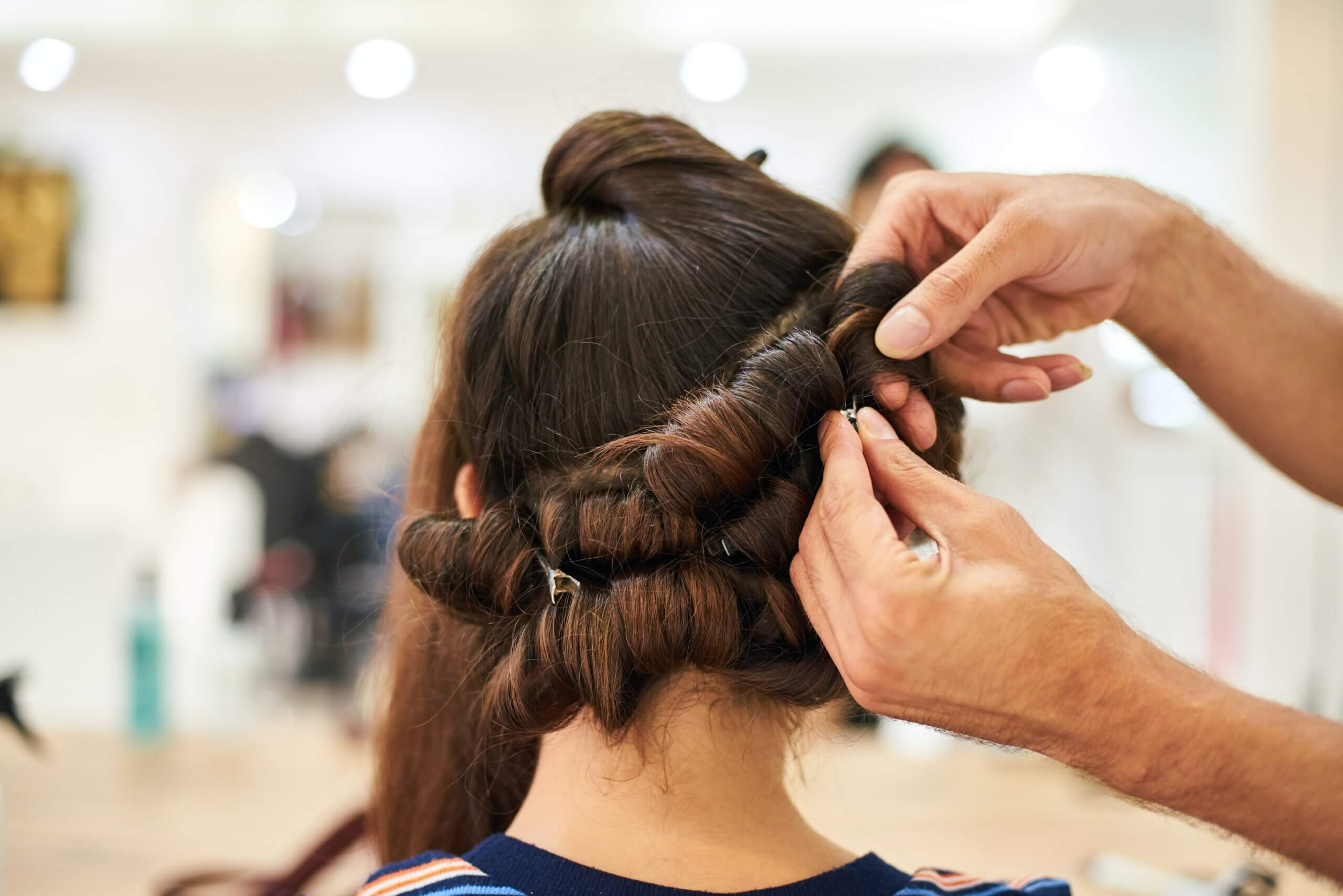 pinning brown hair into curls