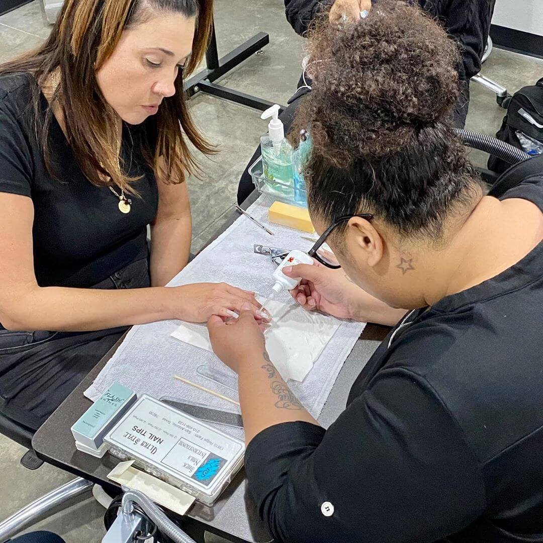 Student doing nails under the supervision of licensed professionals